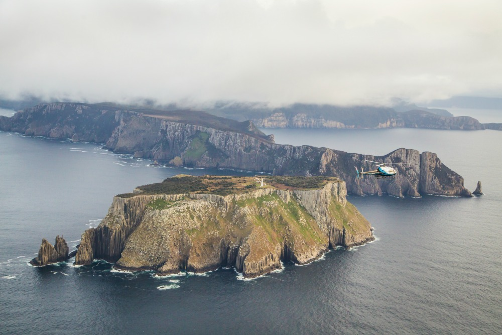 Overfly Tasman Island on a scenic helicopter flight with Osborne Heli Tours